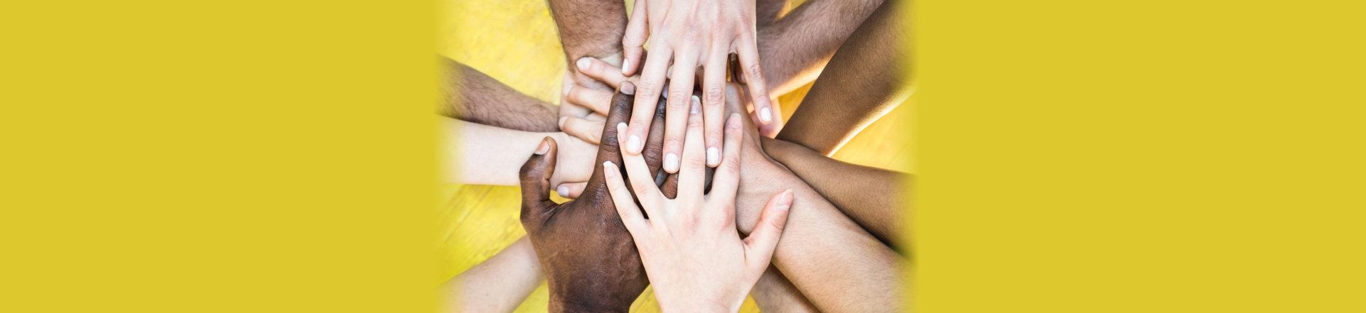 stacks of people hands